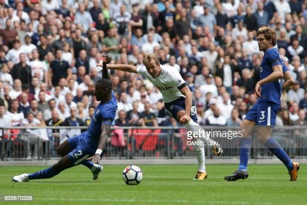 Tottenham Hotspur's English striker Harry Kane shoots but sees his shot saved during the English Premier League football match between Tottenham...