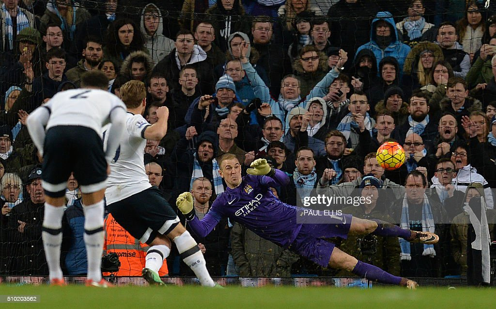 Tottenham Hotspur's English striker Harry Kane (2L) shoots from the penalty spot towards Manchester City's English goalkeeper Joe Hart to score his team's first goalduring the English Premier League football match between Manchester City and Tottenham Hotspur at the Etihad Stadium in Manchester, north west England, on February 14, 2016. / AFP / PAUL ELLIS / RESTRICTED TO EDITORIAL USE. No use with unauthorized audio, video, data, fixture lists, club/league logos or 'live' services. Online in-match use limited to 75 images, no video emulation. No use in betting, games or single club/league/player publications. /
