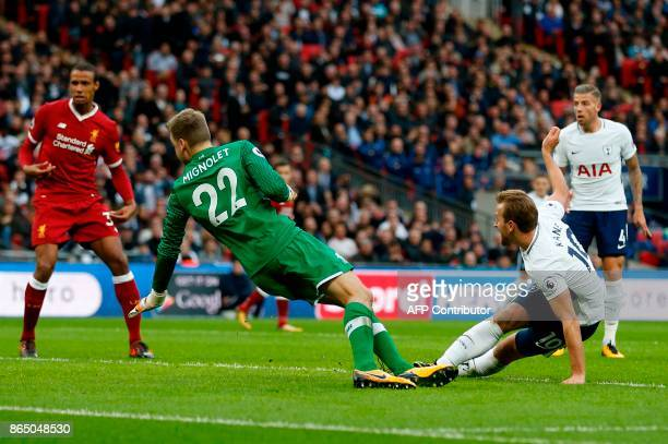 Tottenham Hotspur's English striker Harry Kane shoots past Liverpool's Belgian goalkeeper Simon Mignolet to score their fourth goal during the...