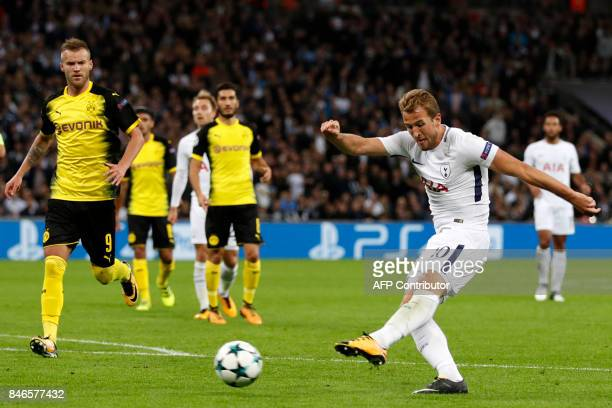 Tottenham Hotspur's English striker Harry Kane shoots to score their third goal during the UEFA Champions League Group H football match between...