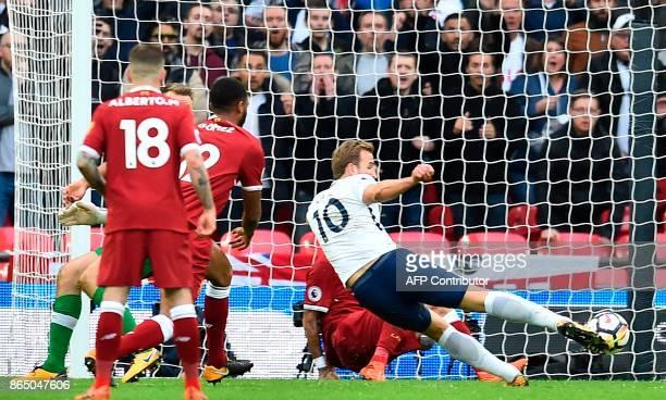 Tottenham Hotspur's English striker Harry Kane shoots to score their fourth goal during the English Premier League football match between Tottenham...