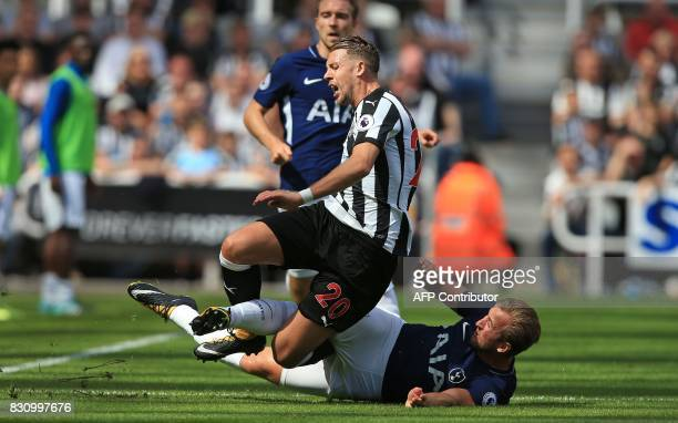 Tottenham Hotspur's English striker Harry Kane slides to tackle Newcastle United's French midfiielder Florian Lejeune during the English Premier...