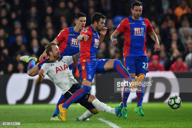 Tottenham Hotspur's English striker Harry Kane takes a shot at goal but misses during the English Premier League football match between Crystal...