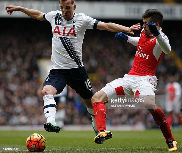 Tottenham Hotspur's English striker Harry Kane vies with Arsenal's Brazilian defender Gabriel during the English Premier League football match...