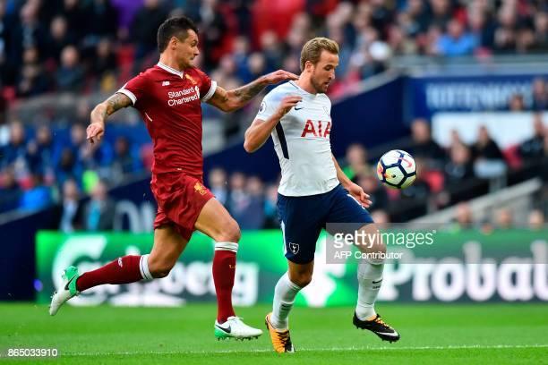 Tottenham Hotspur's English striker Harry Kane vies with Liverpool's Croatian defender Dejan Lovren during the English Premier League football match...
