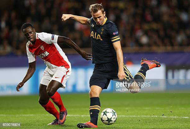 Tottenham Hotspur's English striker Harry Kane vies with Monaco's French defender Benjamin Mendy during the UEFA Champions League group E football...