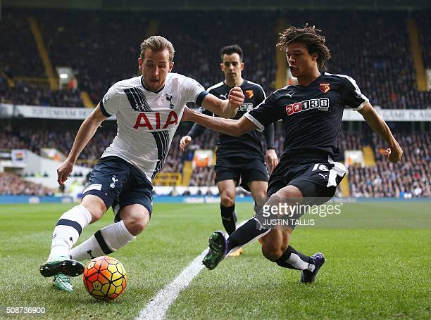 Tottenham Hotspur's English striker Harry Kane vies with Watford's Dutch defender Nathan Ake during the English Premier League football match between...
