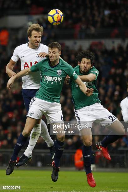 Tottenham Hotspur's English striker Harry Kane vies with West Bromwich Albion's Northern Irish defender Jonny Evans and West Bromwich Albion's...