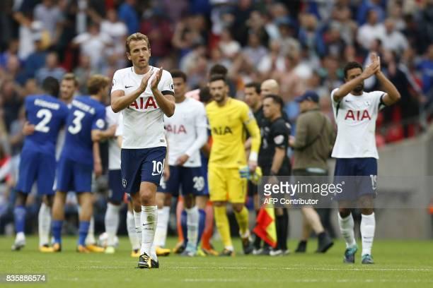 Tottenham Hotspur's English striker Harry Kane walks off after the final whistle during the English Premier League football match between Tottenham...