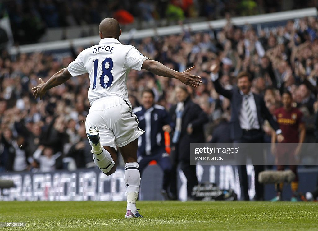 "Tottenham Hotspur's English striker Jermain Defoe (L) celebrates scoring their second goal as Tottenham Hotspur's Portuguese manager Andre Villas-Boas (R) reacts during the English Premier League football match between Tottenham Hotspur and Manchester City at White Hart Lane in north London on April 21, 2013. Tottenham won the game 3-1. USE. No use with unauthorized audio, video, data, fixture lists, club/league logos or ""live"" services. Online in-match use limited to 45 images, no video emulation. No use in betting, games or single club/league/player publications"