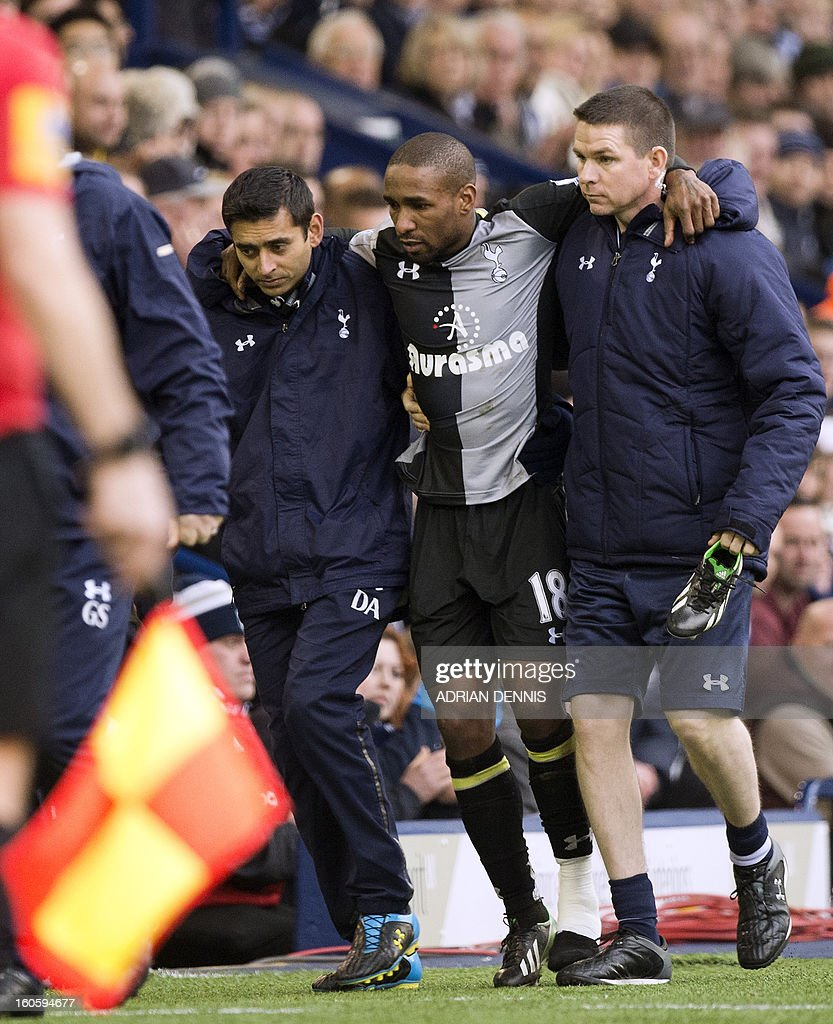 "Tottenham Hotspur's English striker Jermain Defoe (2nd R) is helped from the pitch after picking up an injury during the English Premier League football match between West Bromwich Albion and Tottenham Hotspur at The Hawthorns in West Bromwich, West Midlands, England on February 3, 2013. USE. No use with unauthorized audio, video, data, fixture lists, club/league logos or ""live"" services. Online in-match use limited to 45 images, no video emulation. No use in betting, games or single club/league/player publications."