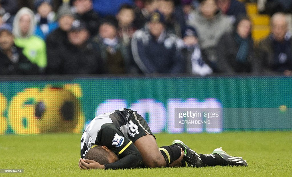 "Tottenham Hotspur's English striker Jermain Defoe lies injured during the English Premier League football match between West Bromwich Albion and Tottenham Hotspur at The Hawthorns in West Bromwich, West Midlands, England on February 3, 2013. USE. No use with unauthorized audio, video, data, fixture lists, club/league logos or ""live"" services. Online in-match use limited to 45 images, no video emulation. No use in betting, games or single club/league/player publications."