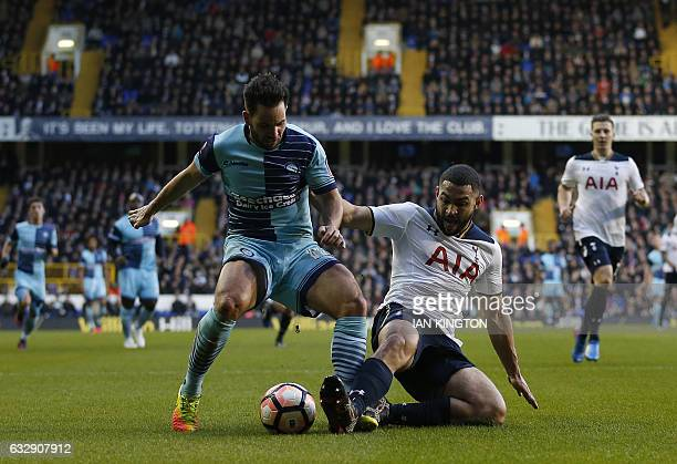 Tottenham Hotspur's Englishborn US defender Cameron CarterVickers concedes a penalty for his challenge on Wycombe Wanderers' English midfielder Sam...