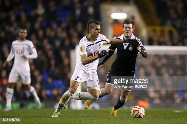 Tottenham Hotspur's Erik Lamela and Partizan Belgrade's ikola Ninkovic battle for the ball