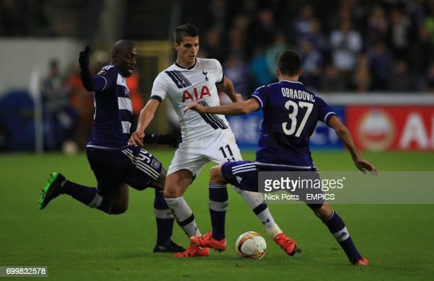 Tottenham Hotspur's Erik Lamela is challenge by Anderlecht's Stefano Okaka and Anderlecht's Ivan Obradovic