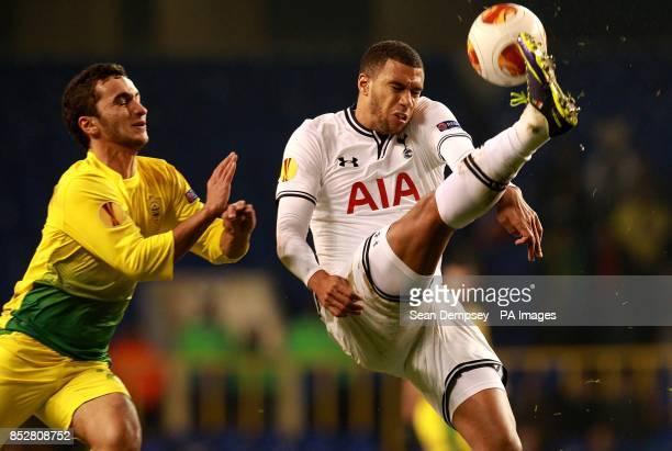 Tottenham Hotspur's Etienne Capoue and Anzhi Makhachkala's Alexandru Epureanu in action