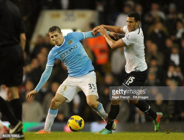 Tottenham Hotspur's Etienne Capoue and Manchester City's Stevan Jovetic battle for the ball