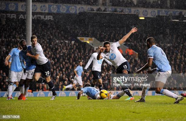 Tottenham Hotspur's Etienne Capoue shoots to score his team's opening goal
