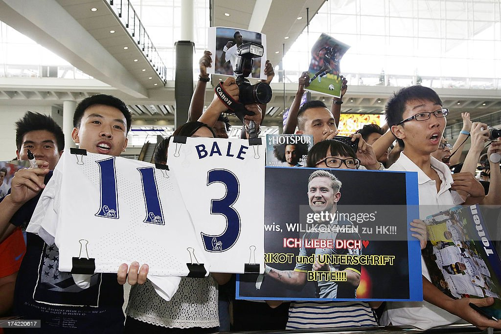 Tottenham Hotspur's fans greet the team at Hong Kong Airport, the Tottenham Hotspur team arrive to compete in the Barclays Asia Trophy, on July 22, 2013 in Hong Kong.