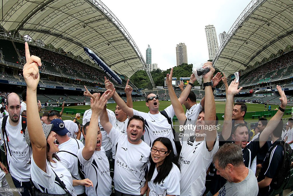 Tottenham Hotspurs fans sing and chant ahead of the start of the Third Place Play-Off match between Tottenham Hotspurs and South China at Hong Kong Stadium on July 27, 2013 in So Kon Po, Hong Kong.