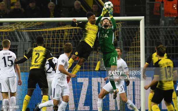 TOPSHOT Tottenham Hotspur's French goalkeeper Hugo Lloris and Dortmund's Gabonese striker PierreEmerick Aubameyang vie for the ball during the UEFA...