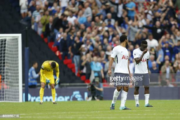 Tottenham Hotspur's French goalkeeper Hugo Lloris and teammates react after Chelsea's second goal during the English Premier League football match...