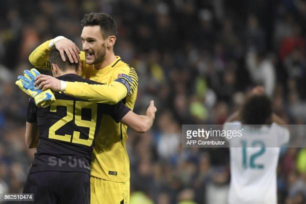 Tottenham Hotspur's French goalkeeper Hugo Lloris and Tottenham Hotspur's English midfielder Harry Winks celebrate after the UEFA Champions League...
