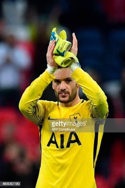 Tottenham Hotspur's French goalkeeper Hugo Lloris applauds supporters on the pitch after the English Premier League football match between Tottenham...