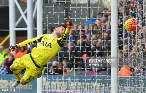 Tottenham Hotspur's French goalkeeper Hugo Lloris dives but fails to stop the ball that is turned into the net by Tottenham Hotspur's Belgian...