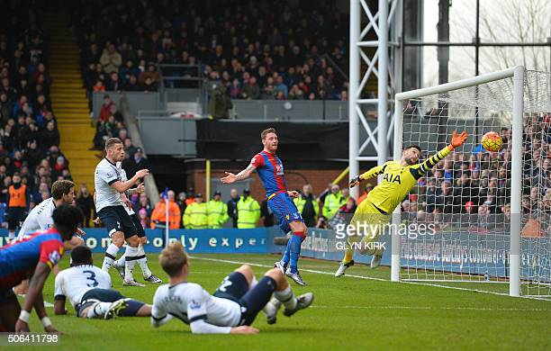 Tottenham Hotspur's French goalkeeper Hugo Lloris dives but fails to stop the ball that is turned into the Tottenham net by Tottenham Hotspur's...