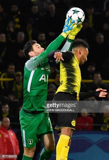 Tottenham Hotspur's French goalkeeper Hugo Lloris gets to the ball before Dortmund's Gabonese forward PierreEmerick Aubameyang during the UEFA...
