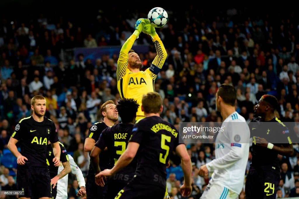 TOPSHOT - Tottenham Hotspur's French goalkeeper Hugo Lloris jumps for the ball during the UEFA Champions League group H football match Real Madrid CF vs Tottenham Hotspur FC at the Santiago Bernabeu stadium in Madrid on October 17, 2017. /