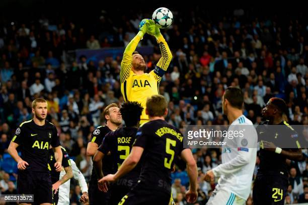 TOPSHOT Tottenham Hotspur's French goalkeeper Hugo Lloris jumps for the ball during the UEFA Champions League group H football match Real Madrid CF...