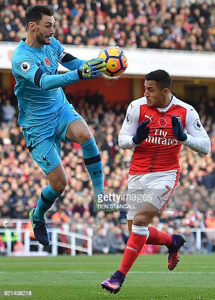 Tottenham Hotspur's French goalkeeper Hugo Lloris vies with Arsenal's Chilean striker Alexis Sanchez during the English Premier League football match...