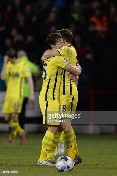 Tottenham Hotspur's French midfielder Benjamin Stambouli embraces Tottenham Hotspur's English midfielder Ryan Mason as they celebrate their victory...