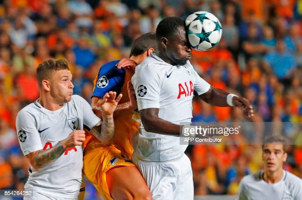Tottenham Hotspur's French midfielder Moussa Sissoko heads the ball clear during the UEFA Champions League football match between Apoel FC and...