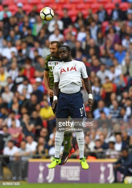 Tottenham Hotspur's French midfielder Moussa Sissoko vies with Juventus' Italian defender Giorgio Chiellini during the preseason friendly football...