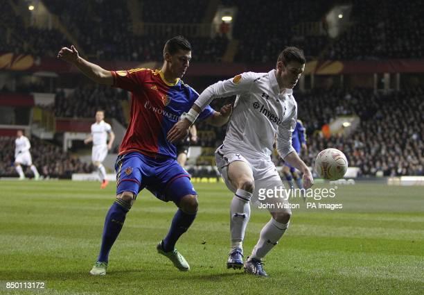 Tottenham Hotspur's Gareth Bale and Basle's Aleksander Dragovic battle for the ball