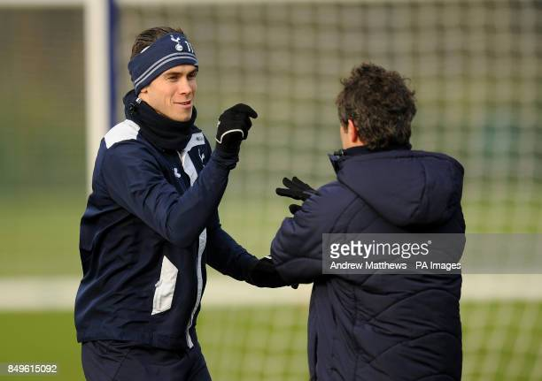 Tottenham Hotspur's Gareth Bale and first team fitness coach Jose Mario Rocha during a training session at Enfield training ground London