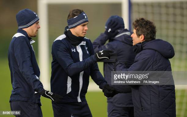 Tottenham Hotspur's Gareth Bale and Gylfi Sigurdsson with first team fitness coach Jose Mario Rocha during a training session at Enfield training...