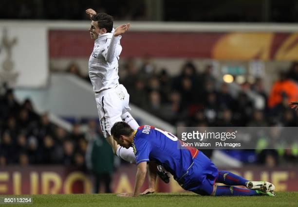 Tottenham Hotspur's Gareth Bale goes down under pressure from Basle's Aleksander Dragovic