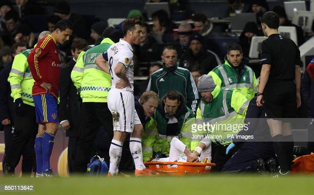 Tottenham Hotspur's Gareth Bale leaves the pitch on a stretcher after picking up an injury