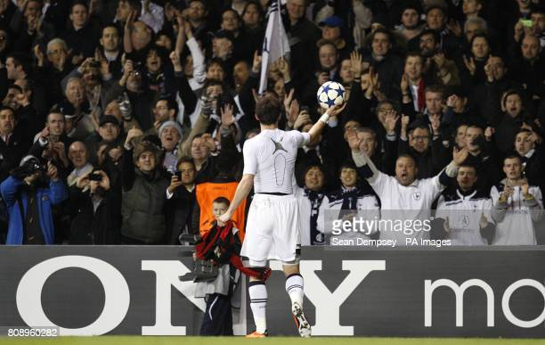 Tottenham Hotspur's Gareth Bale offers the matchball to the crowd as he celebrates winning the tie after the final whistle