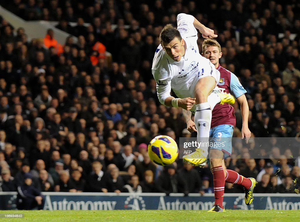 """Tottenham Hotspur's Gareth Bale (L) scores a goal against West Ham during their English Premier League football match at White Hart Lane in North London, England, on 25 November, 2012. Tottenham Hotspur won the match 3-1. USE. No use with unauthorized audio, video, data, fixture lists, club/league logos or """"live"""" services. Online in-match use limited to 45 images, no video emulation. No use in betting, games or single club/league/player publications."""