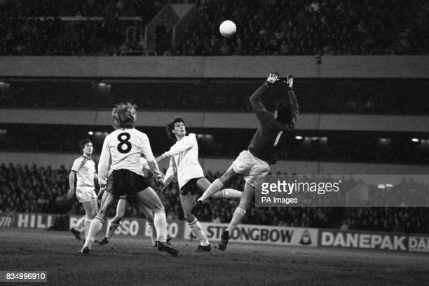 Tottenham Hotspur's Glenn Hoddle taps the ball goalwards but hits the bar with Burnley goalkeeper Alan Stevenson at the ready and Hoddle's teammate...