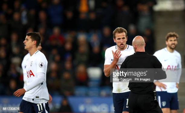 Tottenham Hotspur's Harry Kane appeals the decision of match referee Anthony Taylor as he gives team mate Erik Lamela a yellow card during the...