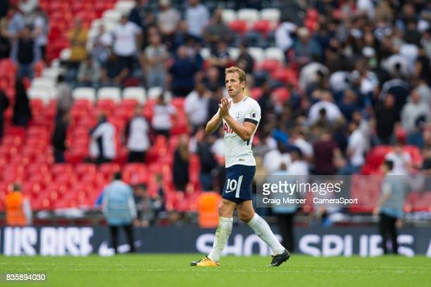 Tottenham Hotspur's Harry Kane applauds the fans at the final whistle during the Premier League match between Tottenham Hotspur and Chelsea at...
