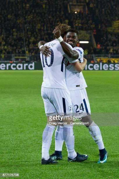 Tottenham Hotspur's Harry Kane celebrates scoring his side's equalising goal to make the score 11 with team mate Serge Aurier during the UEFA...