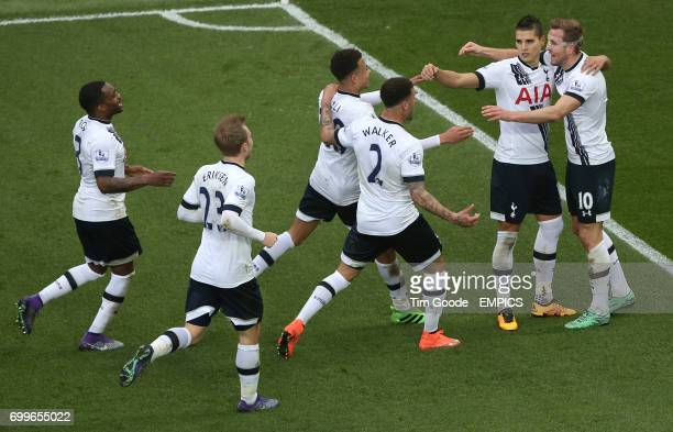 Tottenham Hotspur's Harry Kane celebrates scoring his side's first goal of the game with teammates