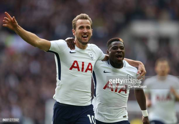 Tottenham Hotspur's Harry Kane celebrates scoring his side's first goal with Serge Aurier during the Premier League match between Tottenham Hotspur...